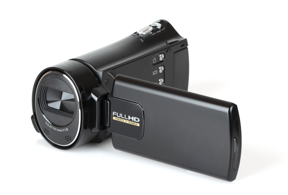 Portable video camera in black on white background.